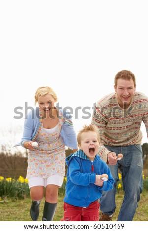 Family Having Egg And Spoon Race - stock photo
