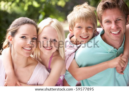Family Having Fun In Countryside Together - stock photo