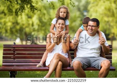 Family having fun in nature. - stock photo