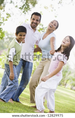 Family having fun in park together - stock photo
