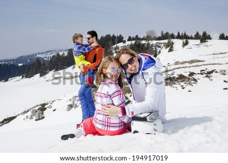 family having fun in the snow
