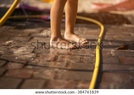 family having fun in the yard playing and resting - stock photo