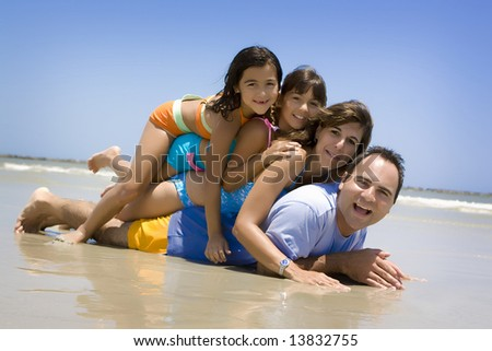 Family having fun on a beach - stock photo