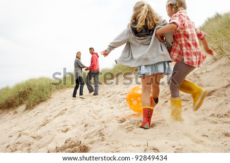 Family having fun on beach vacation - stock photo