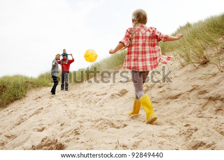 Family having fun on beach vacation - stock photo