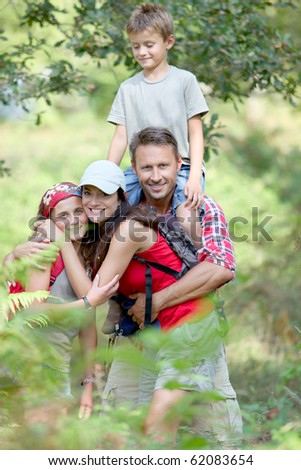 Family having fun on hiking day - stock photo