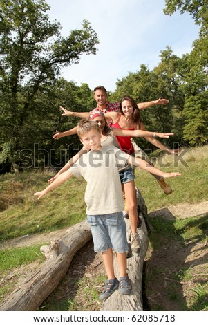 Family having fun on hiking day - stock photo