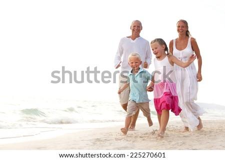 Family having fun on the beach. - stock photo