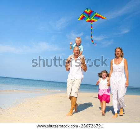 Family having fun on the beach. - stock photo