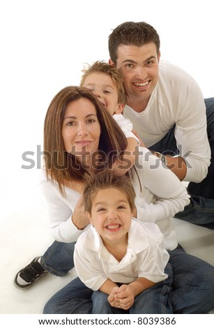 Family having fun on the floor, hugging and smiling - stock photo