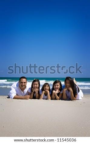 Family having fun on vacations - stock photo