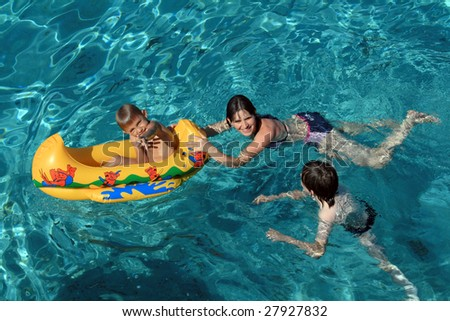 family having fun with an inflatable canoe - stock photo