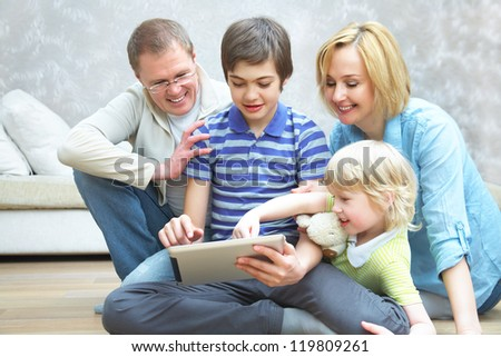 Family Having Fun with gadgets at home - stock photo