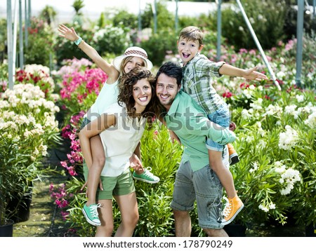 family having fun with in a greenhouse - stock photo