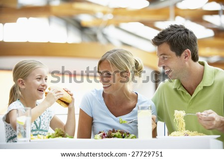 Family Having Lunch Together At The Mall - stock photo