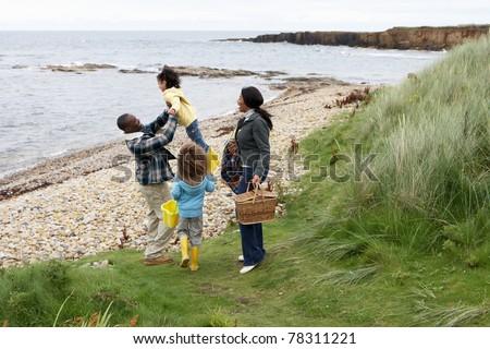Family having picnic - stock photo