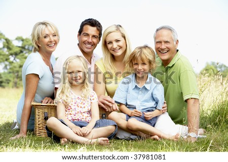 Family having picnic in countryside - stock photo