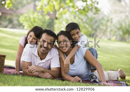 Family having picnic in park - stock photo
