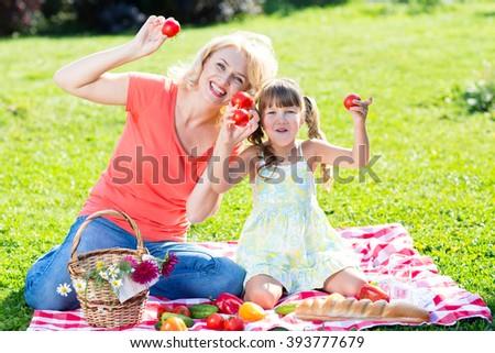 Family having picnic in summer park - stock photo