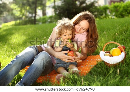 Family having picnic in summer park - stock photo