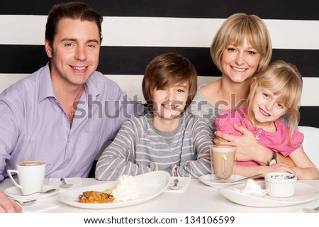 Family having rich breakfast in restaurant.