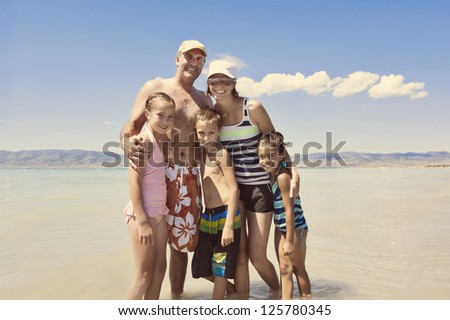 Family having Summer Fun at the Lake - stock photo