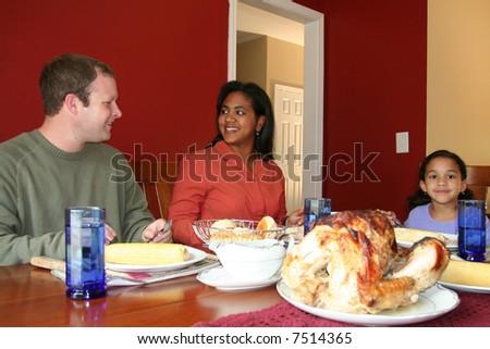 Family having thanksgiving dinner - stock photo
