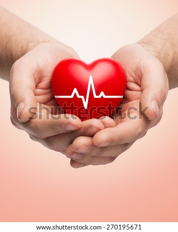 family health, charity and medicine concept - close up of hands holding red heart with cardiogram over beige background - stock photo