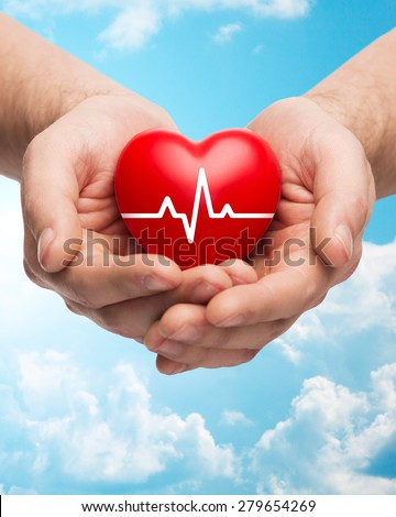 family health, charity and medicine concept - close up of hands holding red heart with cardiogram over blue sky and clouds background - stock photo