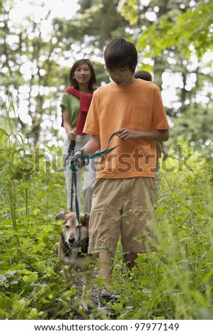 Family hiking with dog - stock photo