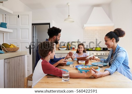 people around kitchen parents helping kids homework kitchen elevated stock photo
