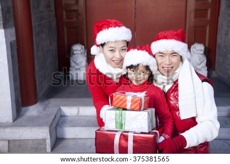 Family Holding Christmas Gifts - stock photo
