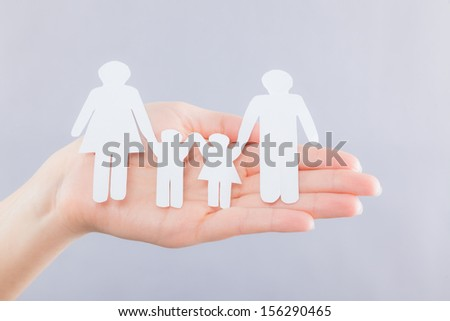 family holding hands for care