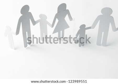 Family holding hands on plain background - stock photo