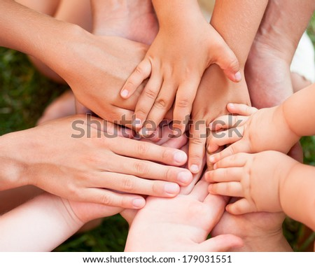 Family holding hands together closeup