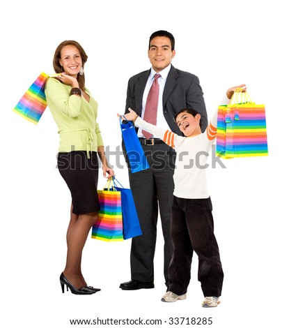 Family holding some shopping bags isolated over white - stock photo