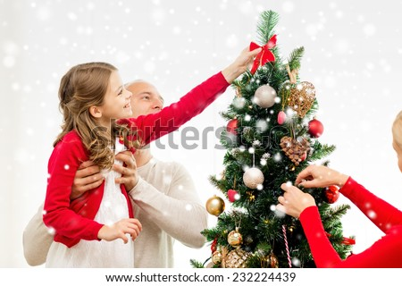 People Decorating For Christmas kids decorating christmas tree stock images, royalty-free images