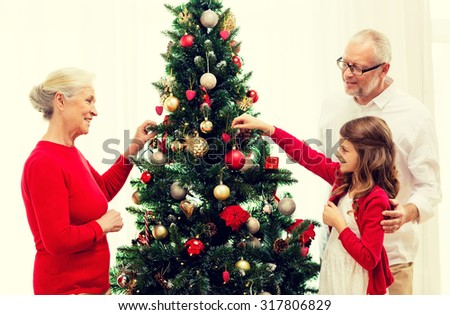 People Decorating For Christmas holiday decorating stock photos, royalty-free images & vectors
