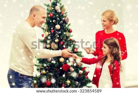 People Decorating A Christmas Tree family xmas winter holidays people concept stock photo 332559449