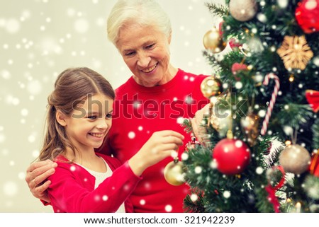 People Decorating christmas kids decorating tree stock images, royalty-free images