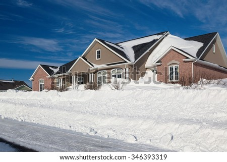 Family home in a north American suburb buried with snow. - stock photo