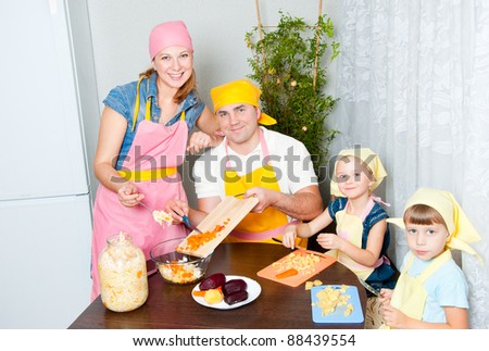 Family home in the kitchen preparing - stock photo