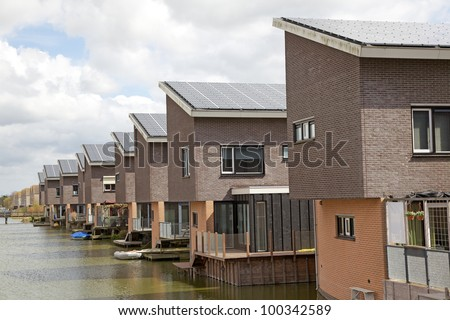 Family homes with Solar panels on the roof - stock photo