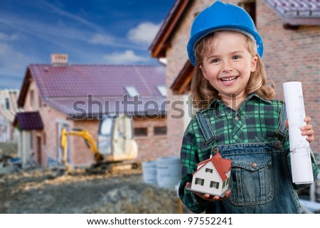 Family house concept - Outdoor portrait of little constructor girl with house model - stock photo