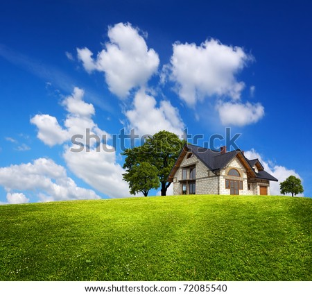Family house on a green hill - stock photo