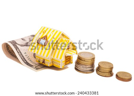 Family House with Dollars and Euro coins - stock photo
