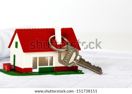 Family house with key. Real estate background. - stock photo