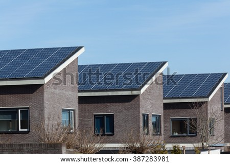 Family house with solar panels for alternative energy
