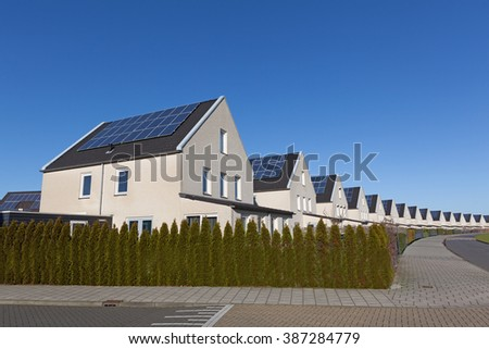 Family house with solar panels for alternative energy - stock photo