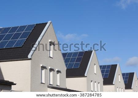 Family house with solar panels for alternative energy - stock photo
